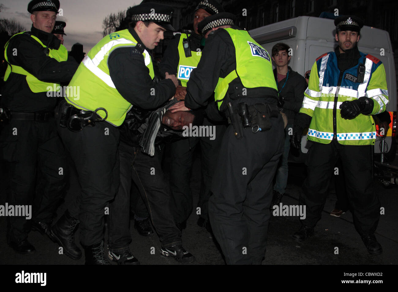 Police arrest protester at Congolese demonstration - Stock Image