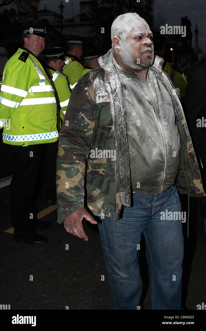 A Congolese protester Covered in white powder during protest in Whitehall on Saturday - Stock Image