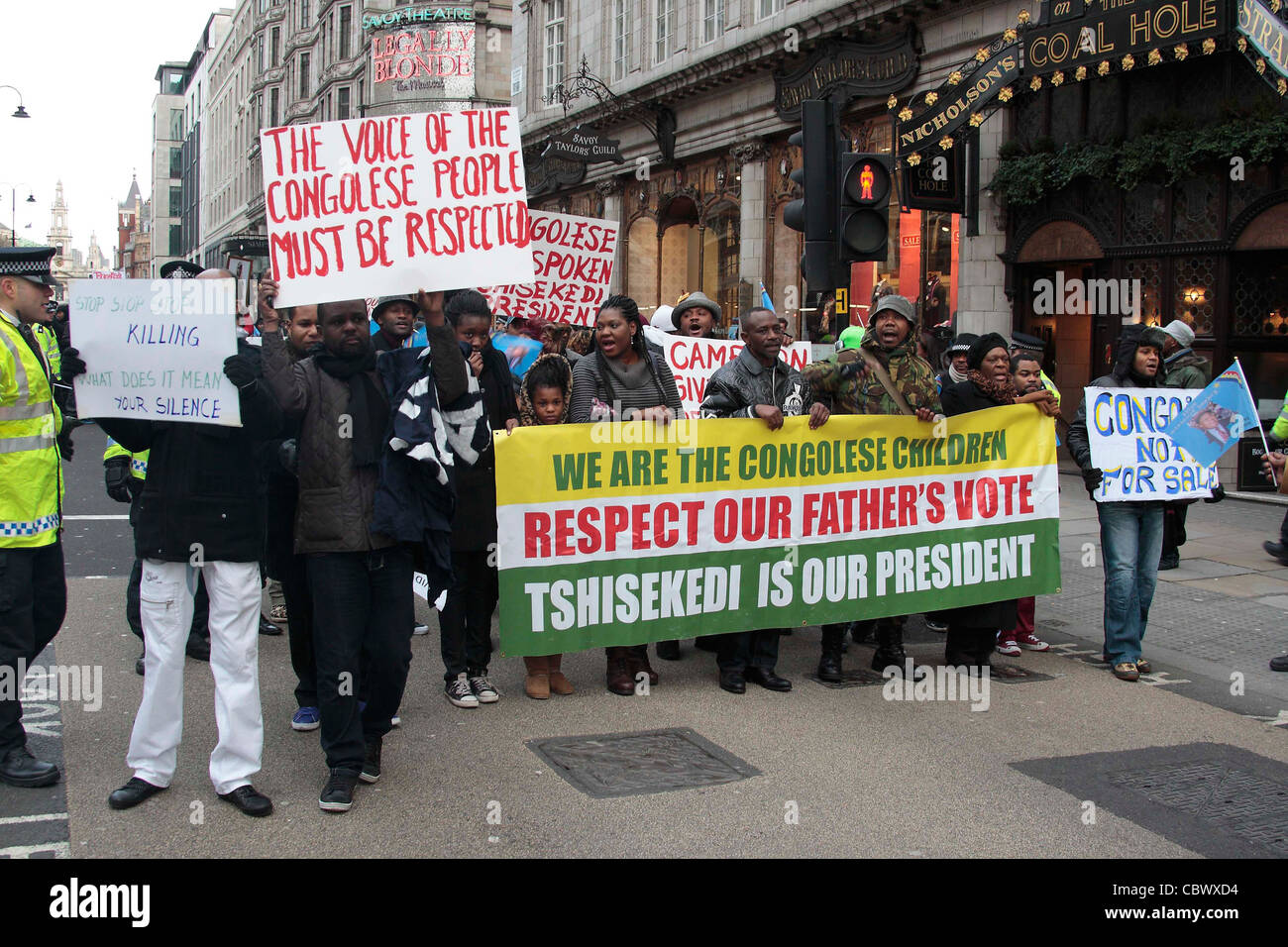 Congolese demonstrators march down the Strand in London - Stock Image
