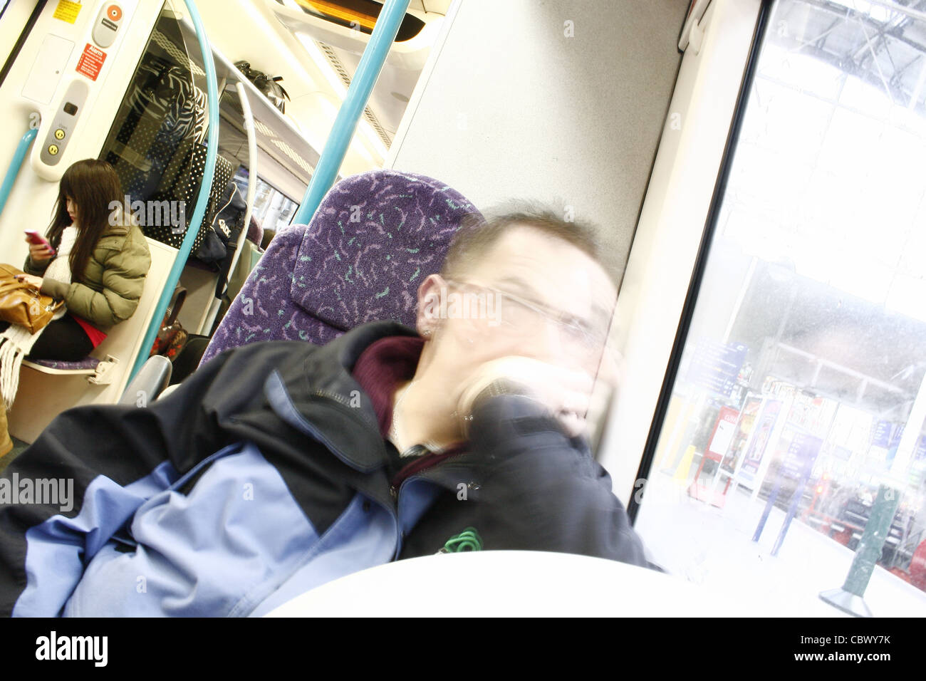 people travelling on northern rail train - Stock Image