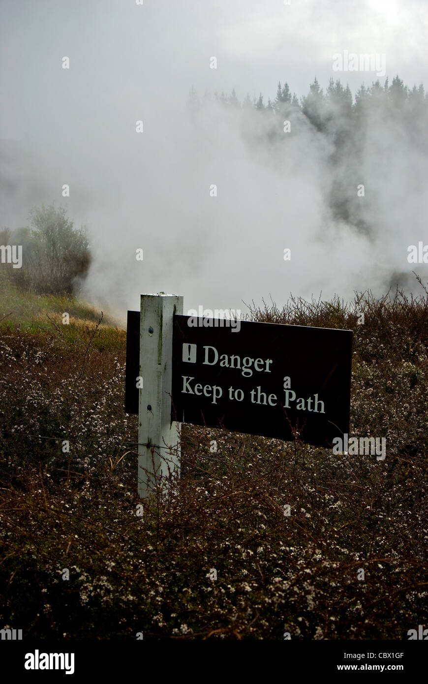 Warning sign Craters of the Moon dangerous geothermal steam vents Lake Taupo New Zealand - Stock Image