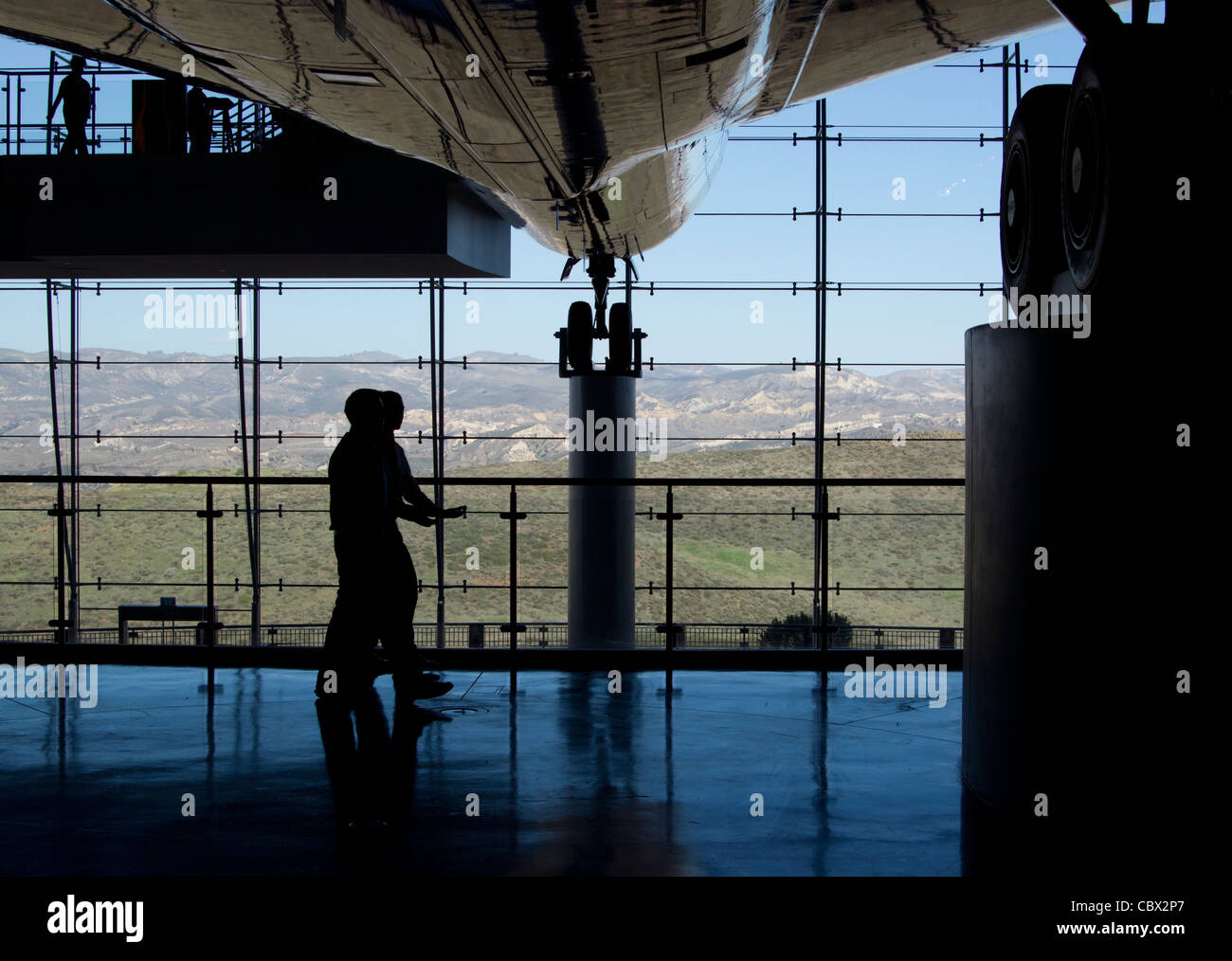 Two men walking underneath Air force One on display at the Ronald Regan Presidential Library - Stock Image