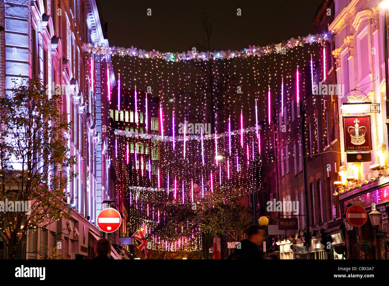 Pink Christmas Lights And Decorations At Seven Dials In Covent Garden Stock Photo Alamy