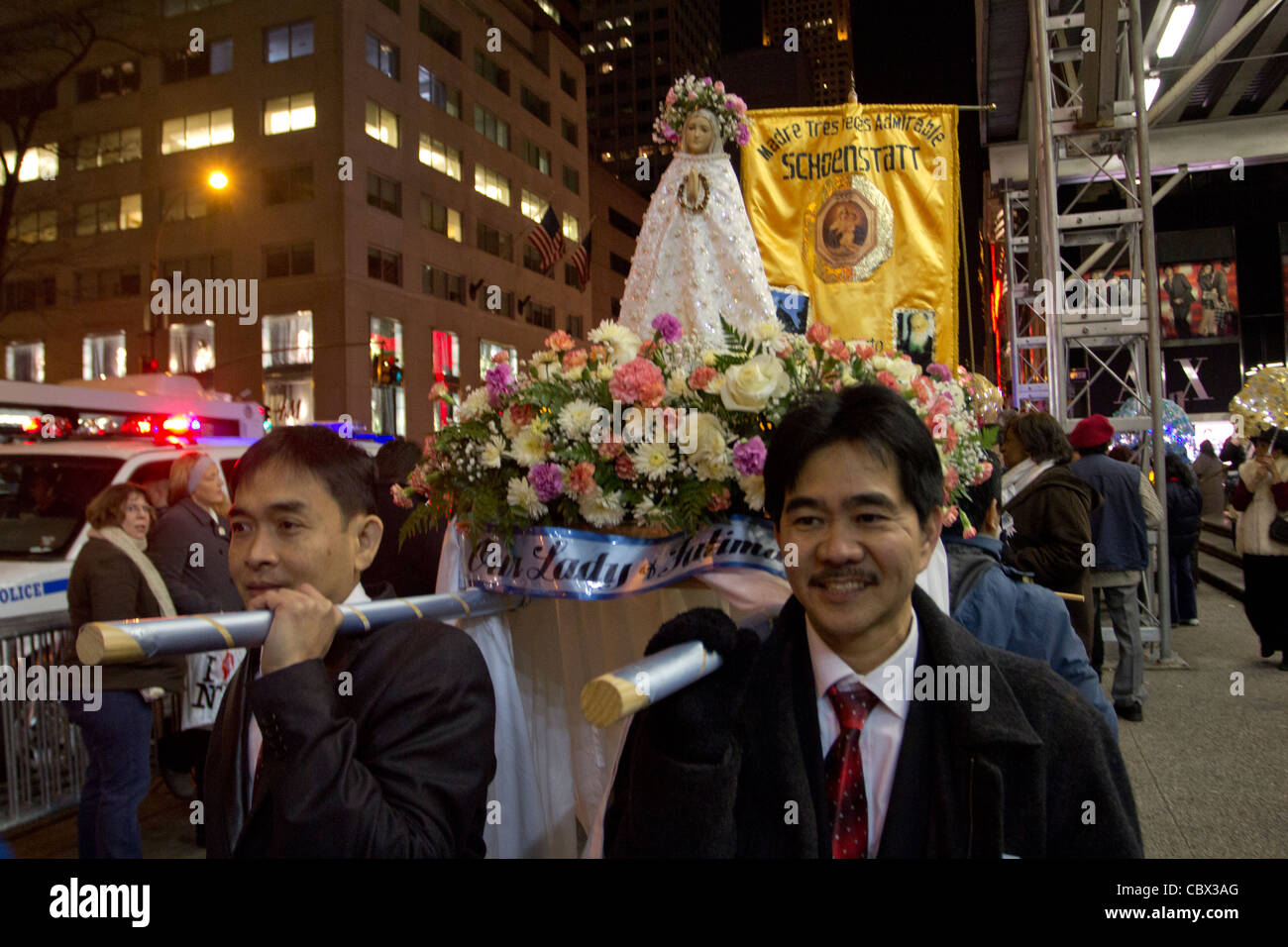 A Filipino Simbang Gabi procession heads to St. Patrick's Cathedral in New York City on the evening of December - Stock Image