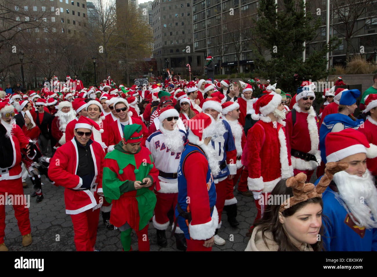 Thousands dressed as Santa Claus converge on New York's World Financial Center on December 10 2011 for Santacon - Stock Image