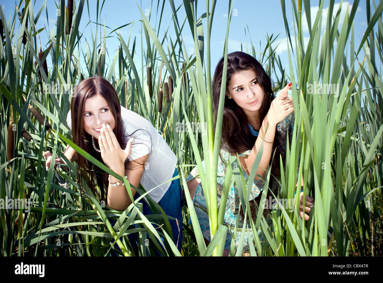 Beautiful models in the tall reeds - Stock Image
