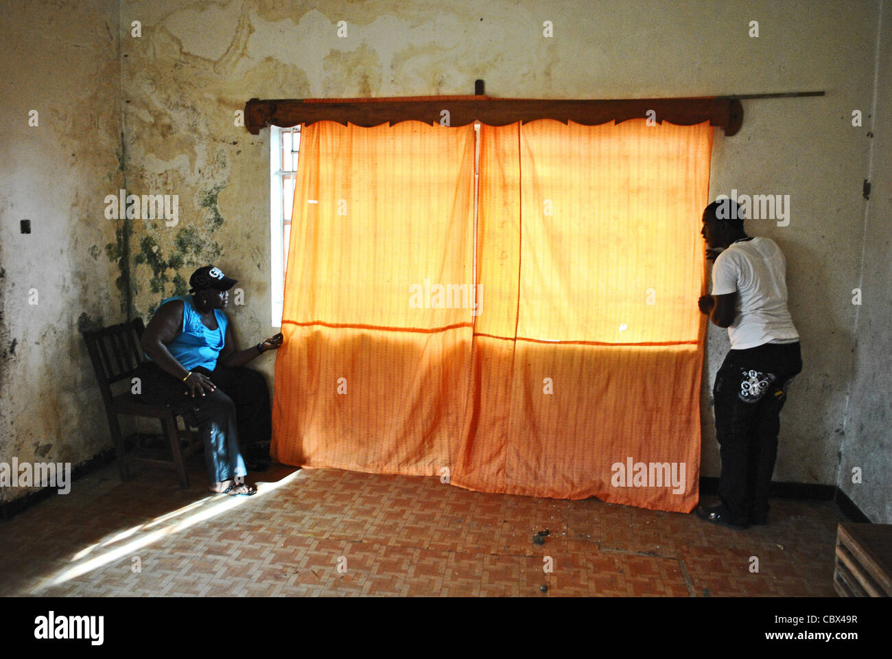 Civilians hide as gunfights continue in Bo, Sierra Leone, during clashes at a political rally ahead of 2012 elections - Stock Image
