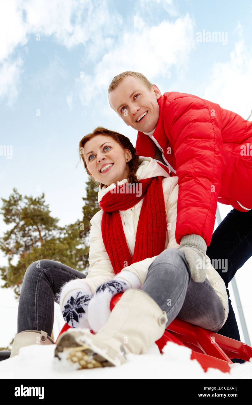 Portrait of happy couple having nice time during winter vacation - Stock Image