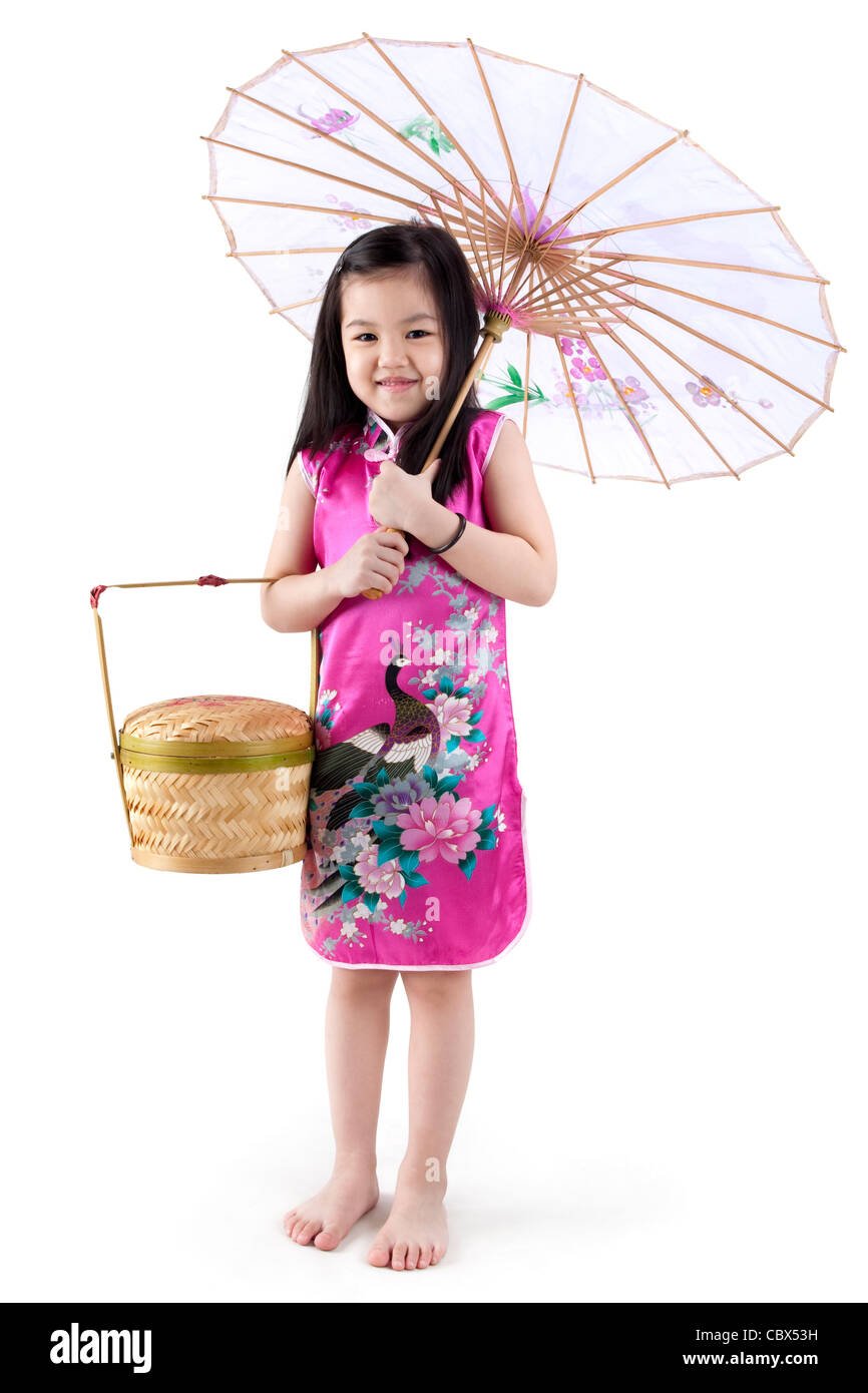 2d1b572f9 Little oriental girl in traditional Chinese dress cheongsam with umbrella  and basket - Stock Image