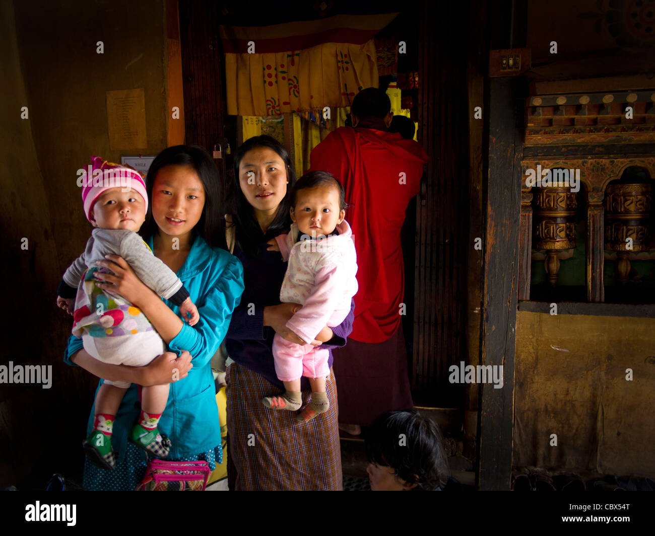 Asia, Bhutan, Changangkha Lhakhang, child, children, mother, son, Thimpu, woman, women - Stock Image