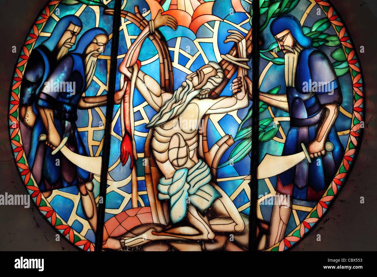 Stain glass window in Catholic Church of Jesus being sacrificed on the cross. Catbalogan, Samar Province, Visayas, - Stock Image