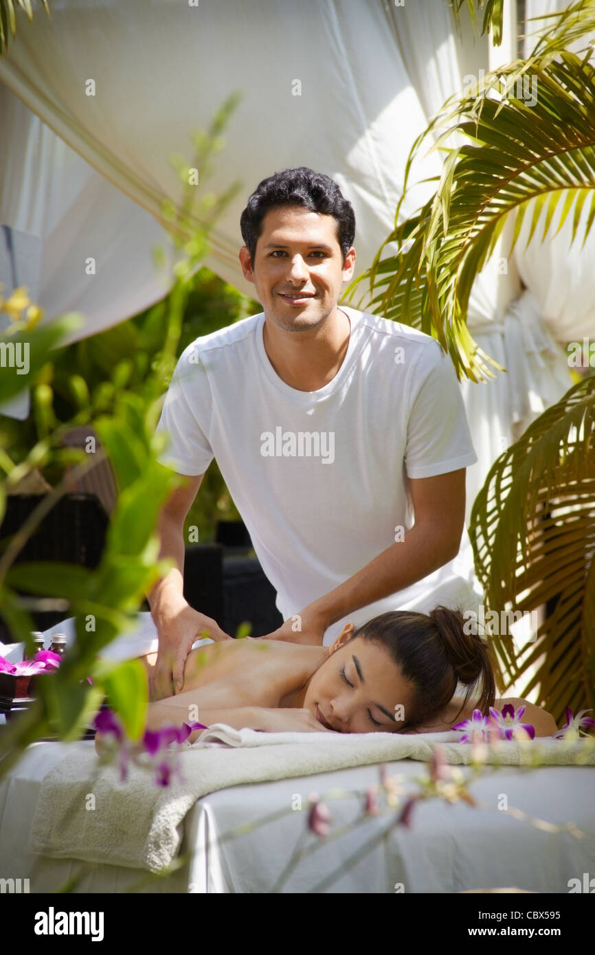 Young beautiful asian woman gets massage and beauty treatment in luxury resort - Stock Image