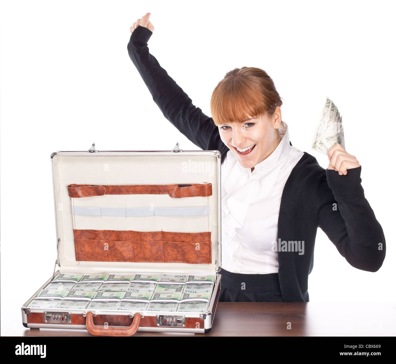 Brown briefcase full of hundred zloty money isolated on white Stock Photo