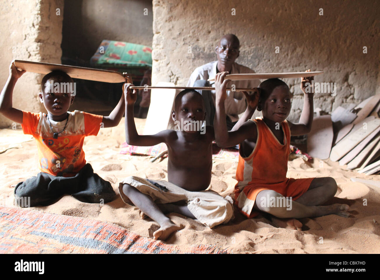 Boys in a Koran school, in Djenne, Mali, Africa. Mali, Africa - Stock Image