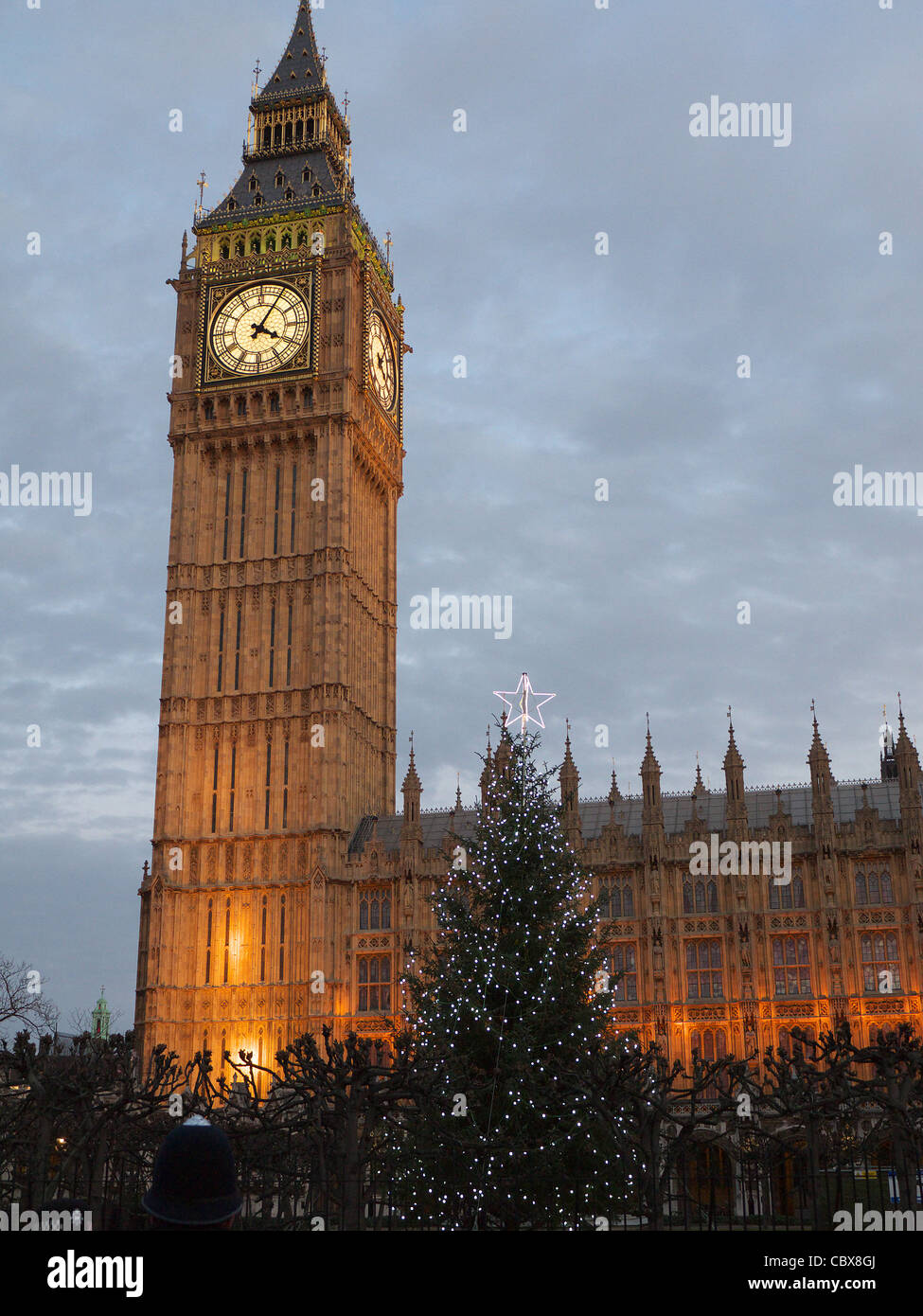 View of 'Big Ben' and Houses of Parliament London at early evening with a Christmas Tree in the foreground - Stock Image