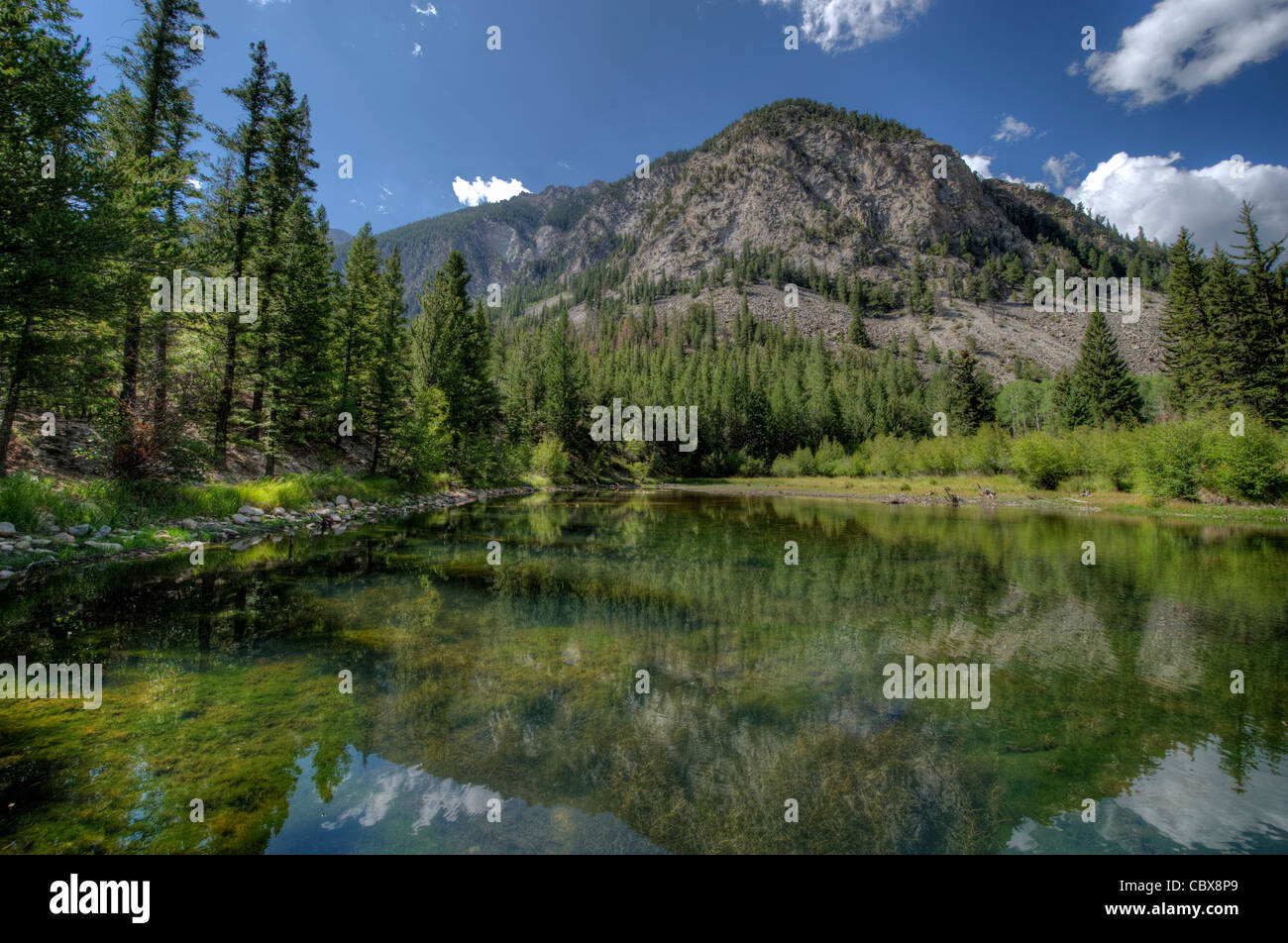 A small, unnamed lake at the 9,000-foot level beside County Road 162 in Chaffee County, Colorado. - Stock Image