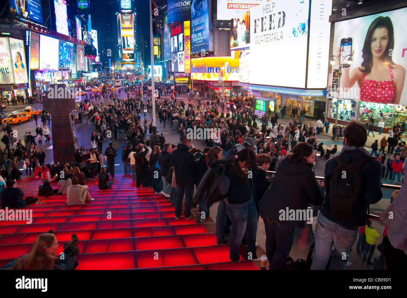 Times Square panorama from the height of red stairs of Duffy Square, New York City, USA Stock Photo