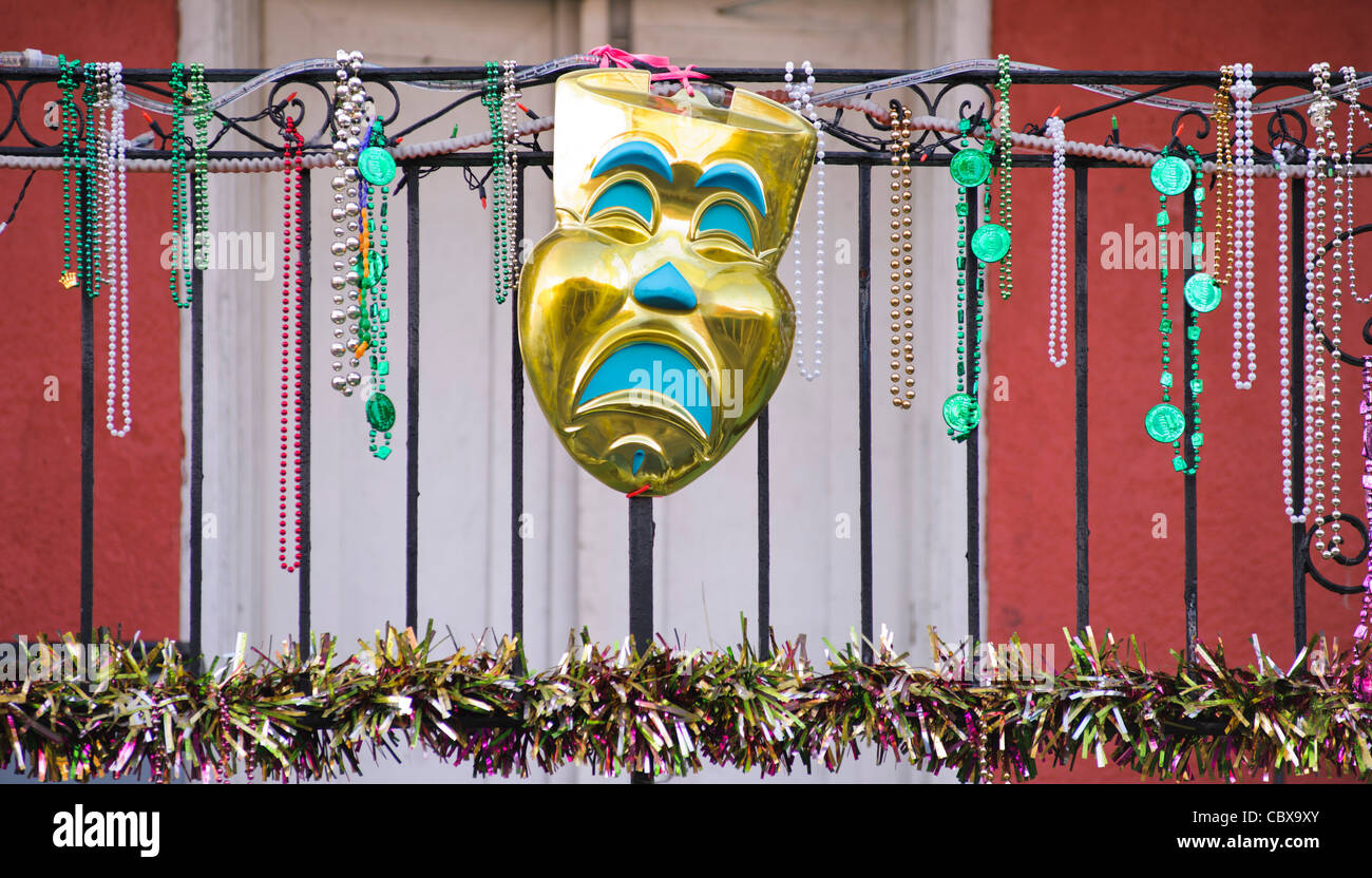 Mardi Gras beads hanging on balcony railing, New Orleans - Stock Image