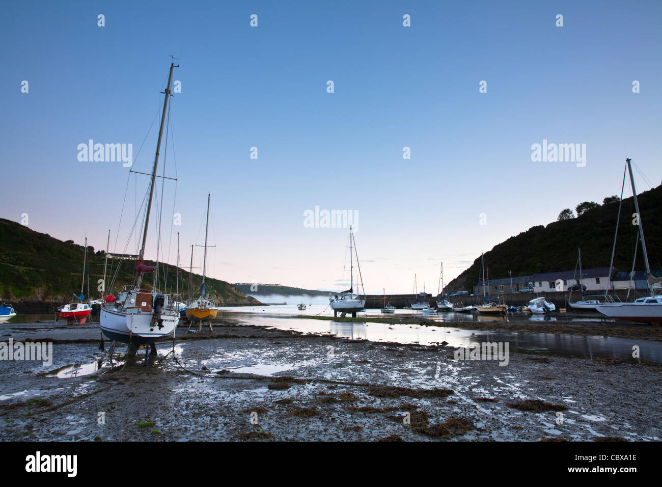 Summer dawn over the lower town harbour, Fishguard on the Pembrokeshire coast, Wales - Stock Image