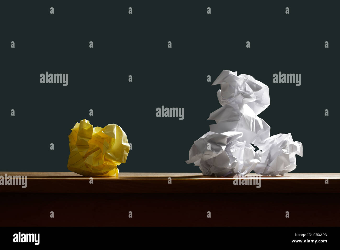 Crumpled paper on desk - Stock Image