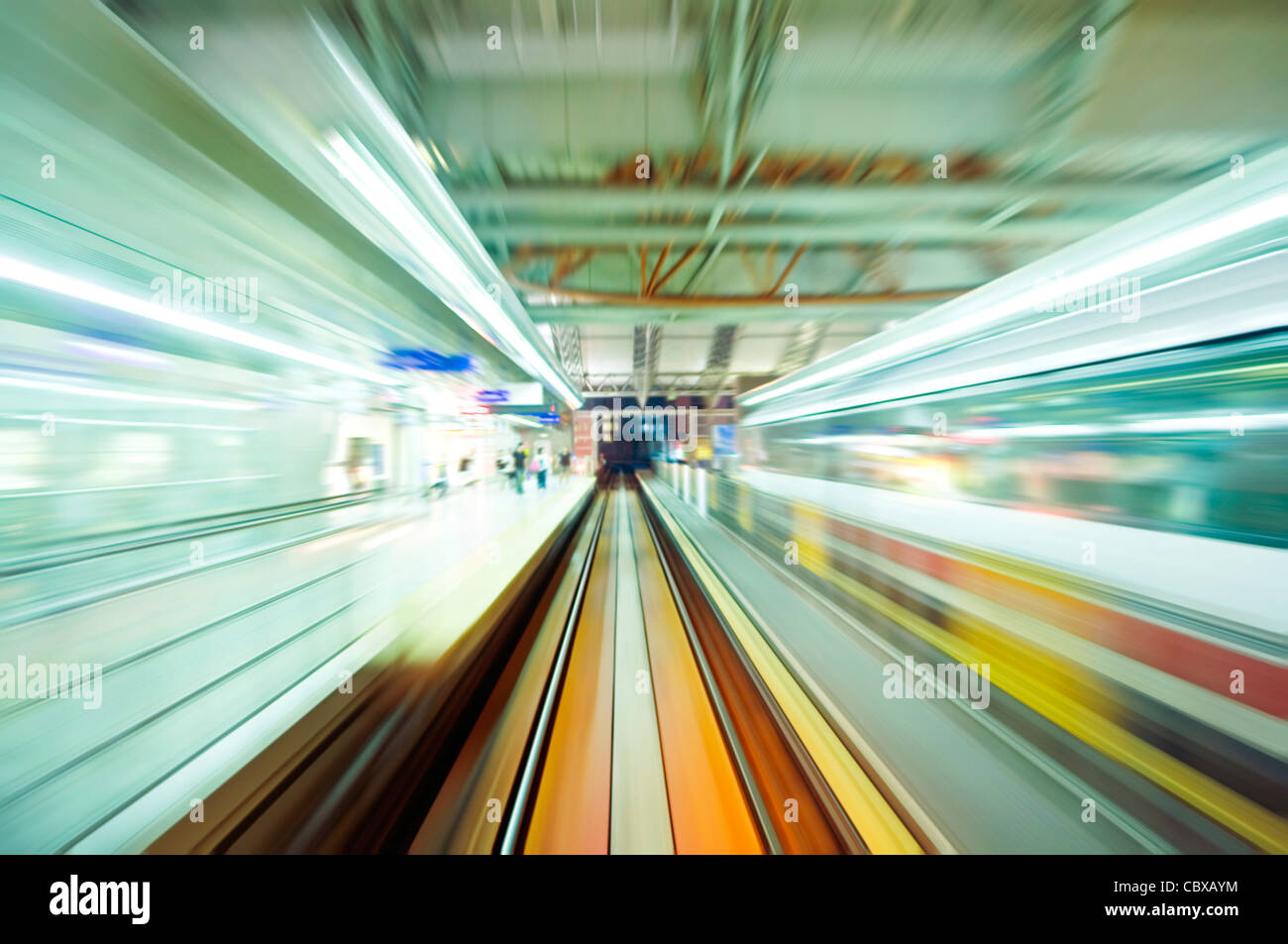 Abstract of fast train passing station with motion blur - Stock Image