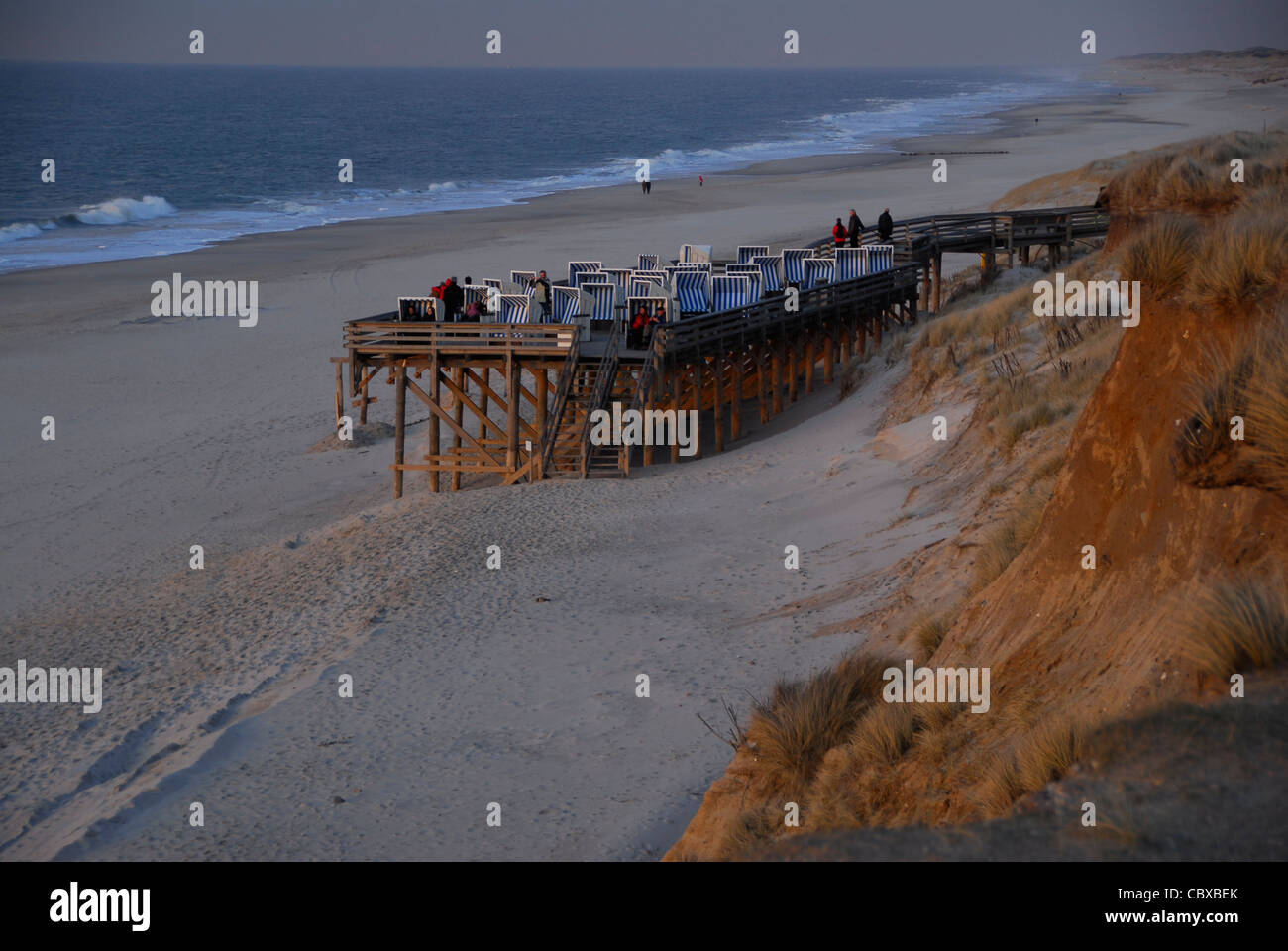 At the beach of the North Frisian island of Sylt, viewing piers are erected close to the cliffs to carry the beach Stock Photo