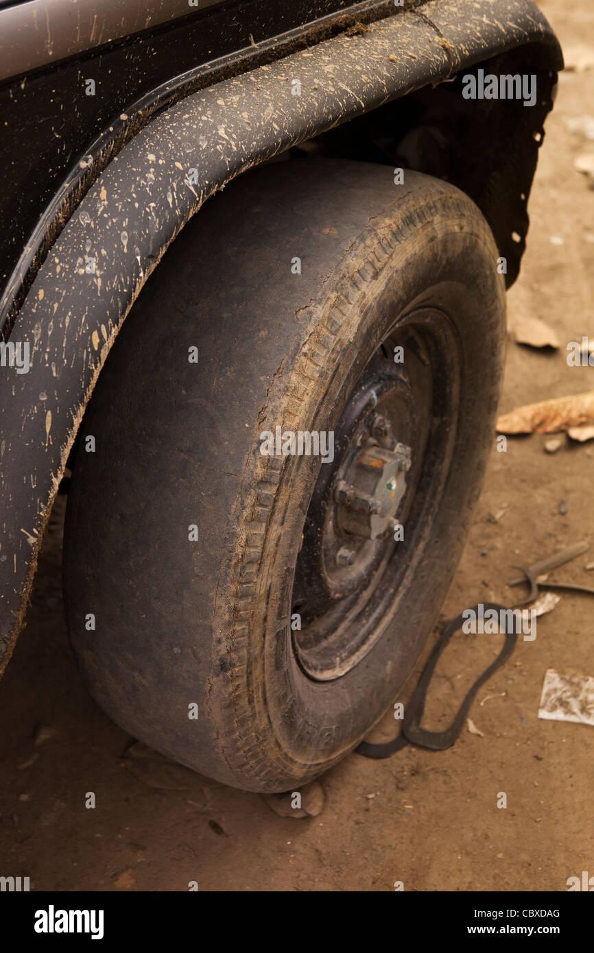 India, Arunachal Pradesh, Along, bald tyre with no tread on tourist transport vehicle - Stock Image