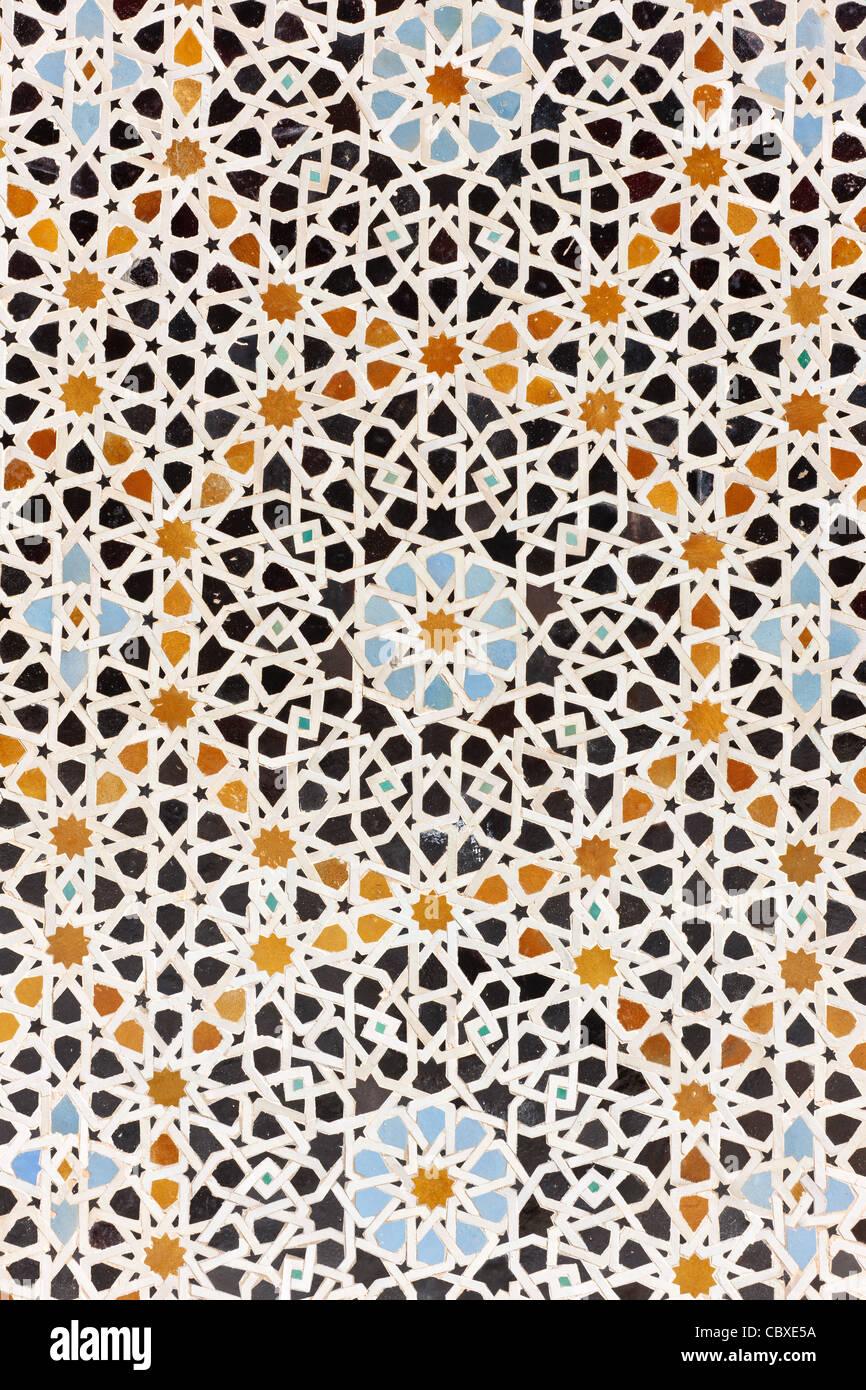 Arabic tiles mosaic in the Ben Youssef Madressa. Marrakesh, Morocco. - Stock Image