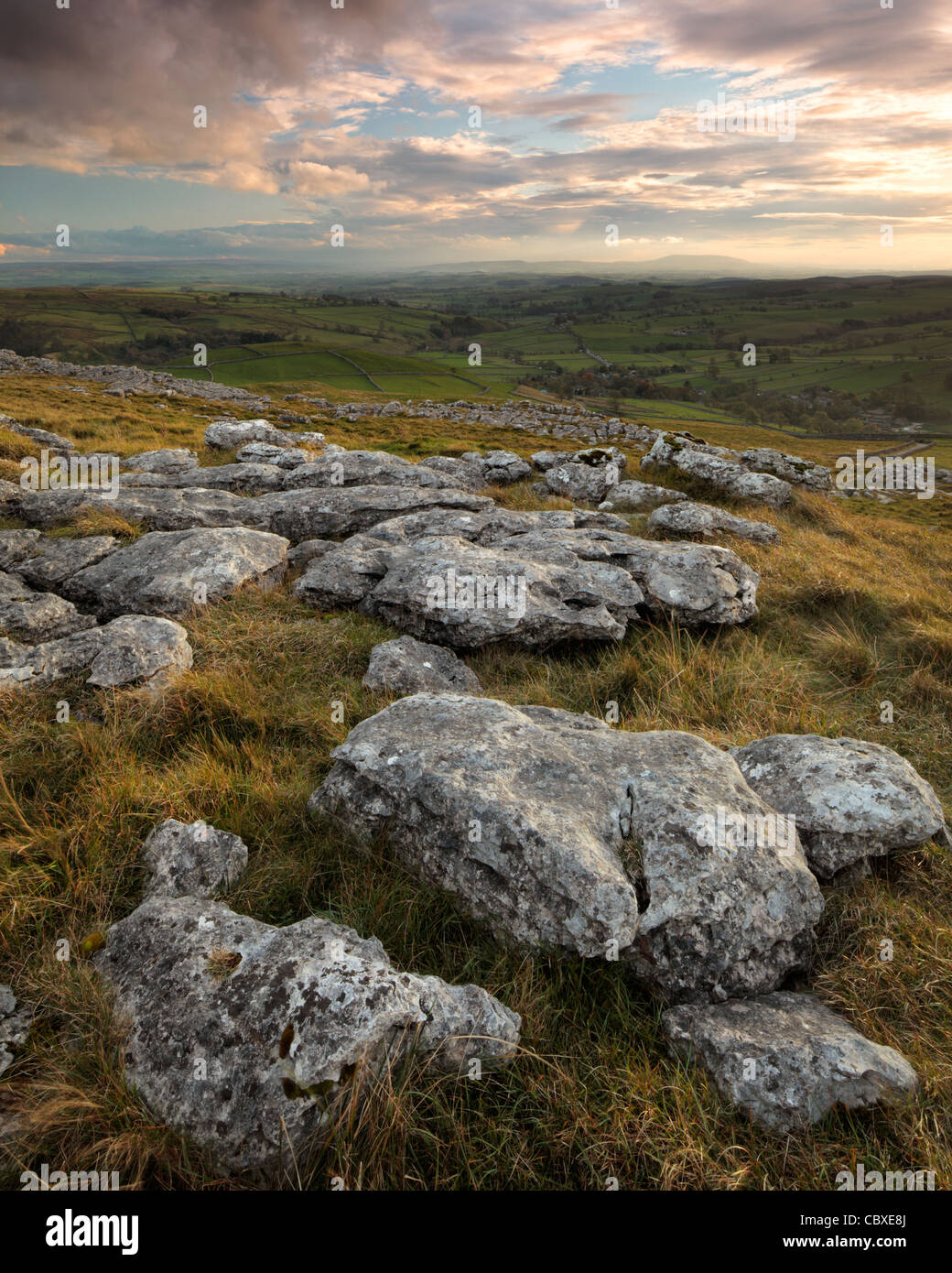Evening light on the beautiful and rugged landscape of Malhamdale, Yorkshire, England - Stock Image