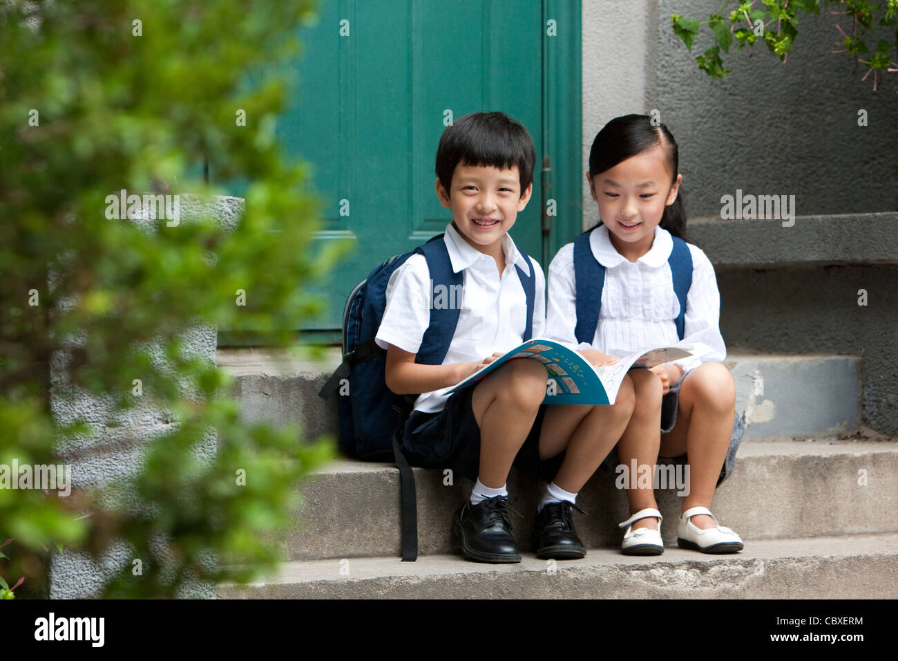 Two school children studying outside - Stock Image