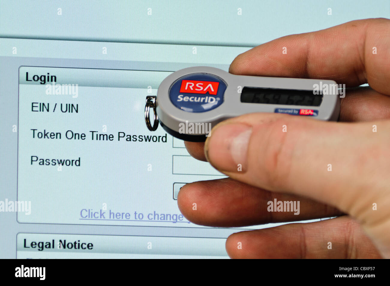 Man uses SecurID token to log into a website needing a userID, Passcode and Password - Stock Image