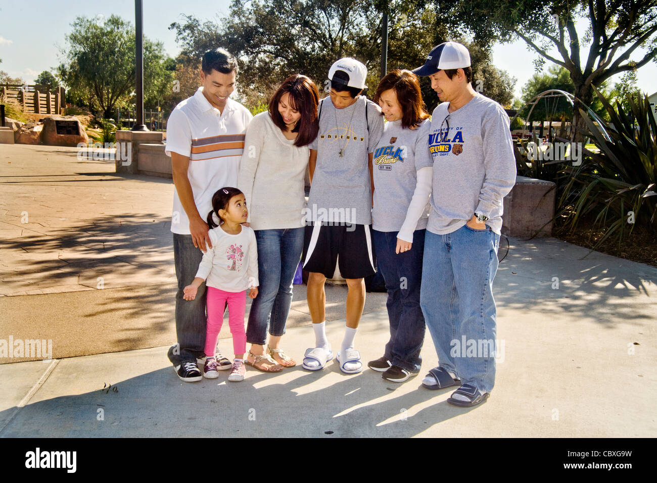 A  Vietnamese-American mother, her Filipino American husband and their four-year-old racially mixed daughter meet - Stock Image