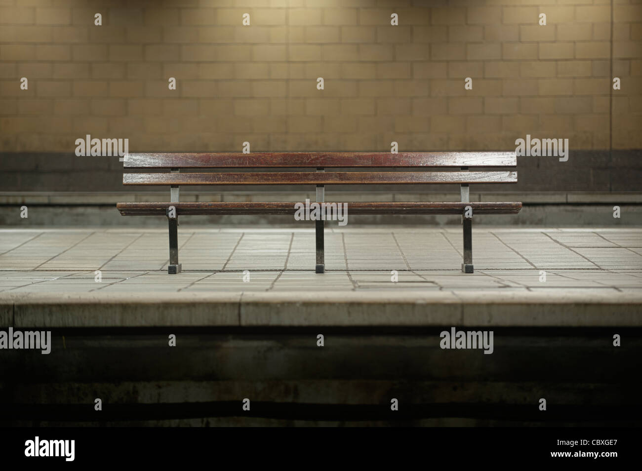 A passenger bench without people sits alone at Victoria station in Manchester, suggesting a rail strike. - Stock Image