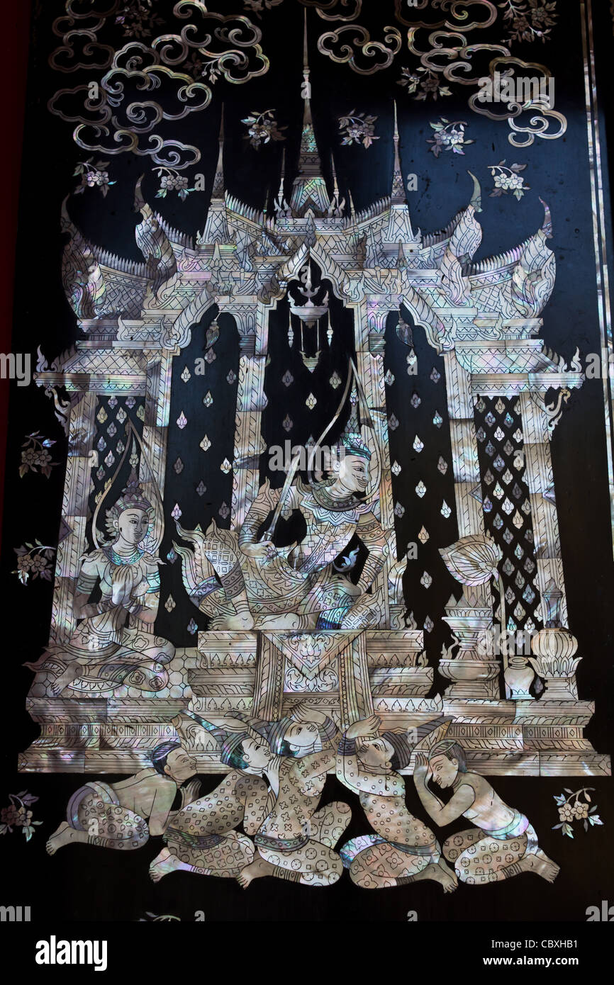 Traditional Thai style church door art, decorated with pieces oyster shell - Stock Image