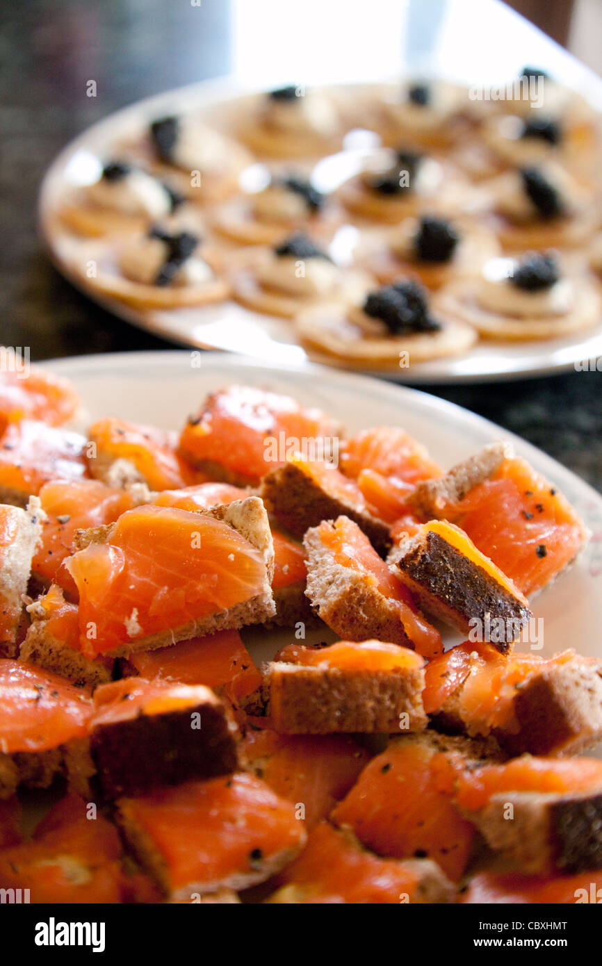 smoked salmon on bread and blinis with caviar, Christmas food UK - Stock Image