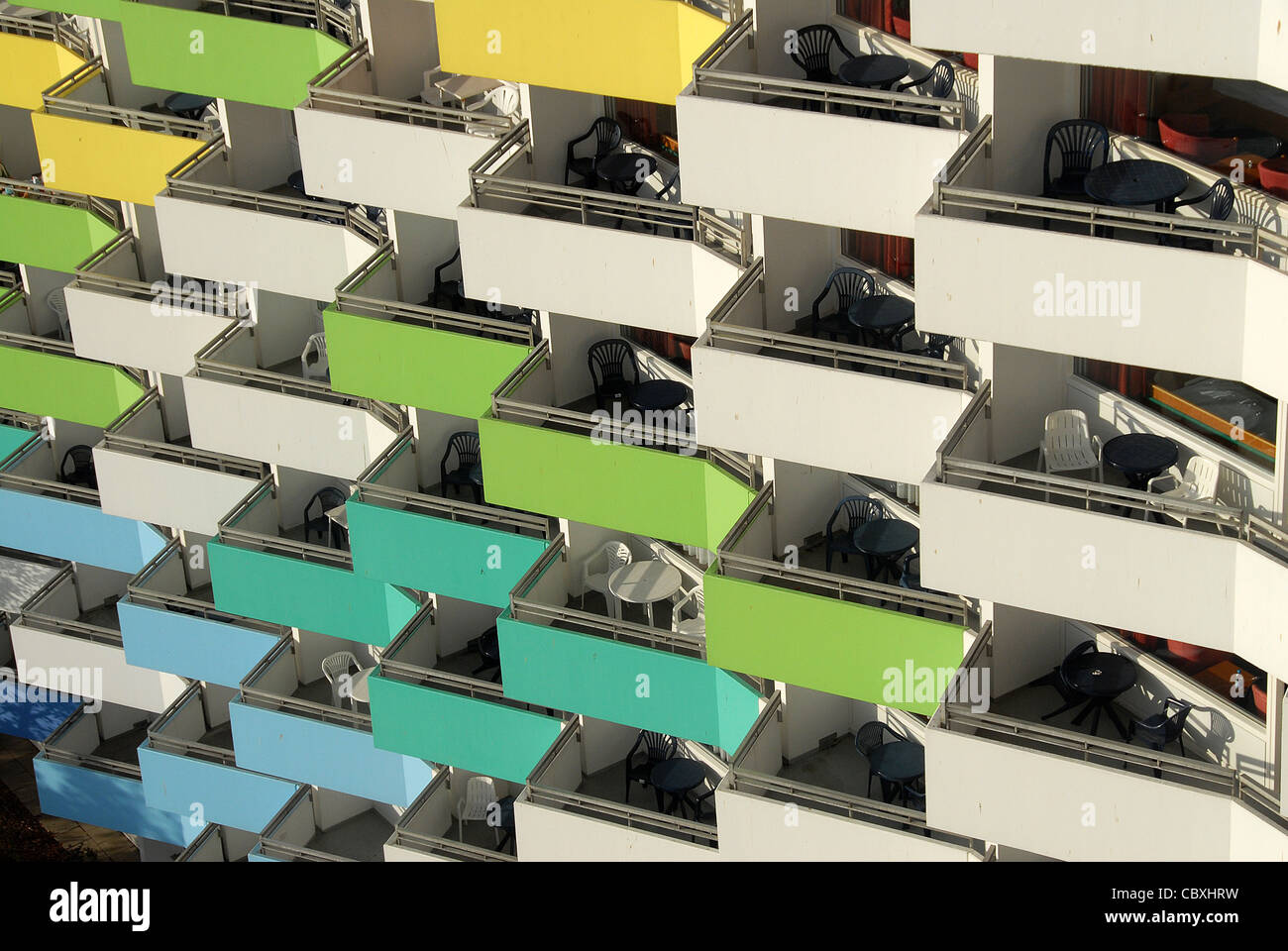 Colourful balconies on the facade of the Ostseebad Damp,the premium accommodation of the seaside/health resort at - Stock Image