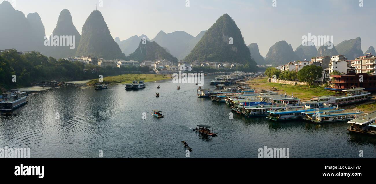 Panorama of Green Lotus Peak overlooking Yangshuo town harbor on the Li Jiang river China - Stock Image