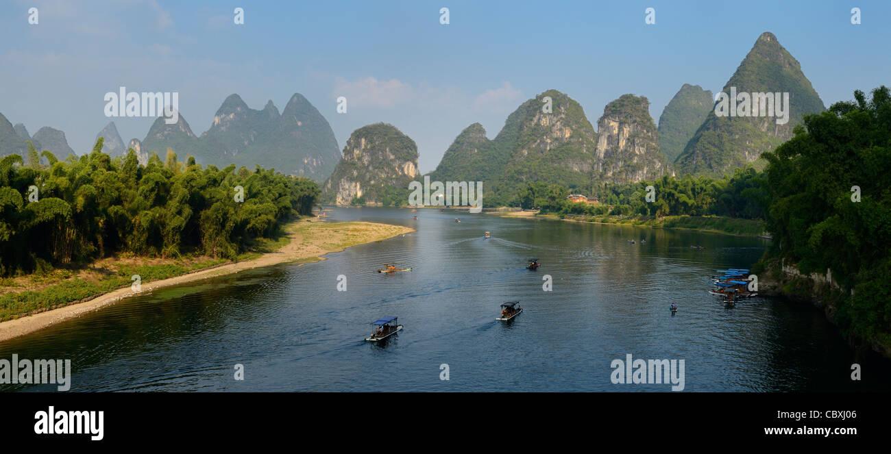 Panorama of karst limestone peaks surrounding the Lijiang river at Yangshuo China - Stock Image