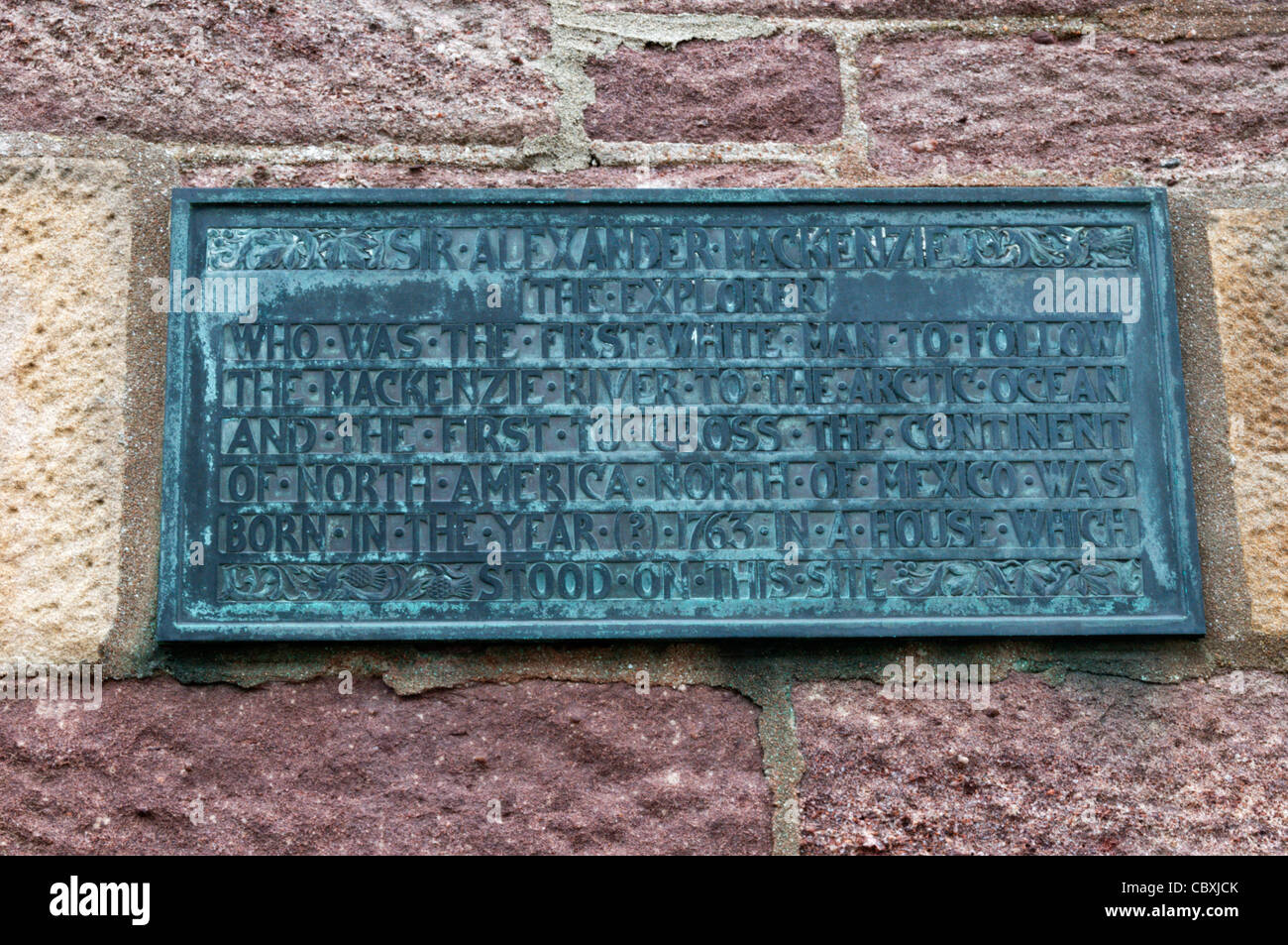 A plaque on the side of Martin's Memorial Church in Stornoway marks the site of Sir Alexander Mackenzie's - Stock Image