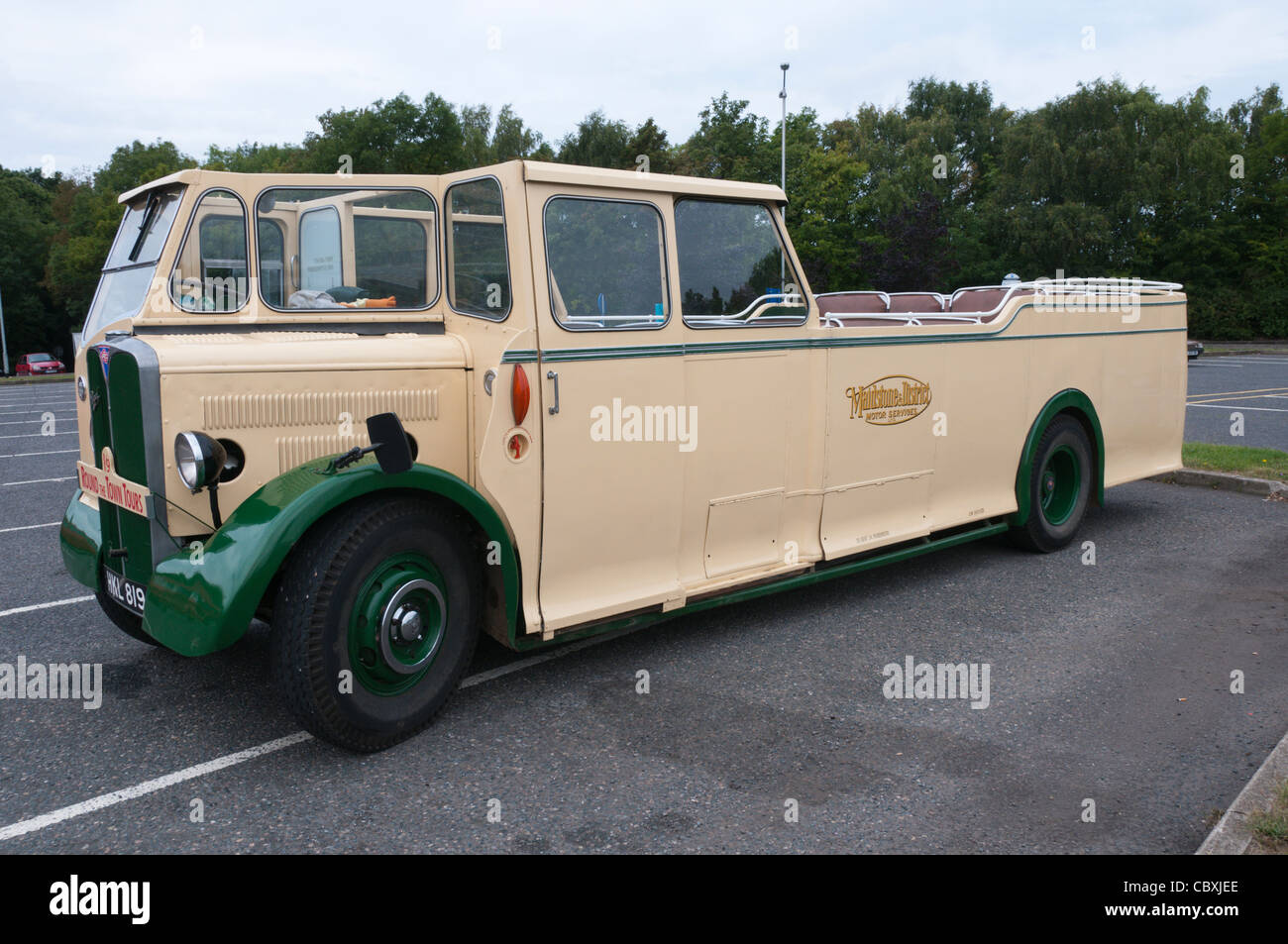 An old Maidstone & District AEC Regal bus that has been converted to an open topped charabanc. - Stock Image