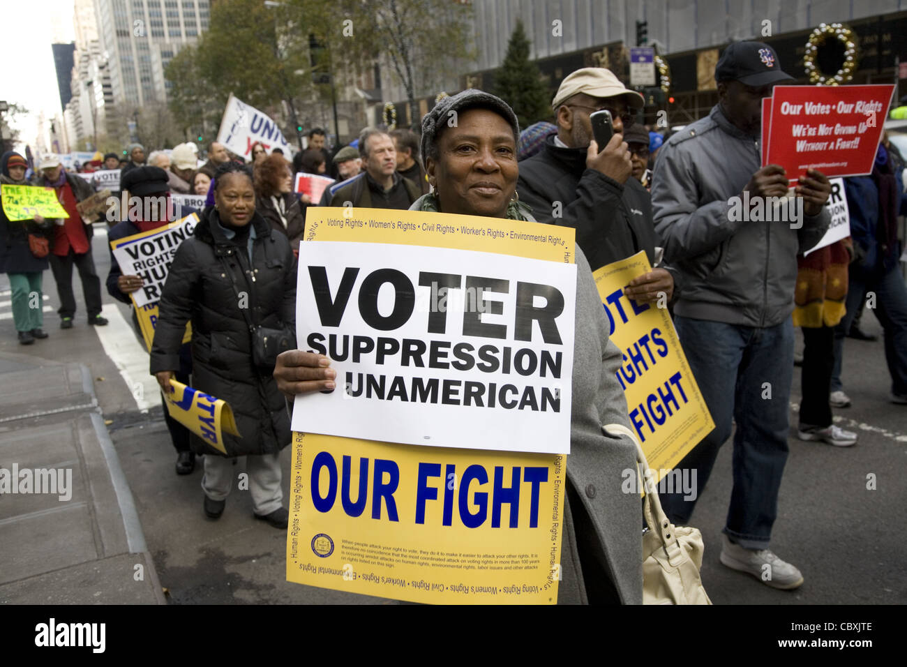 Union members and others march in NYC against payed political influence peddling in many states curtailing voters - Stock Image
