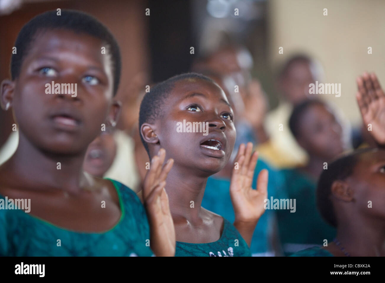 A youth choir sings and dances at a church in Morogoro, Tanzania, East Africa. - Stock Image