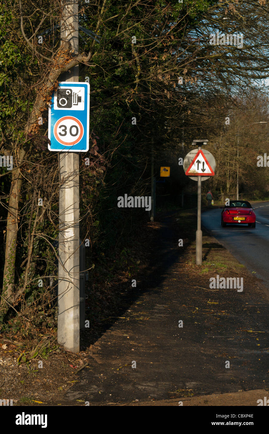 Roadside 30 mph speed limit and speed and safety camera warning sign on the A413 Amersham Road at Chalfont St Peter - Stock Image