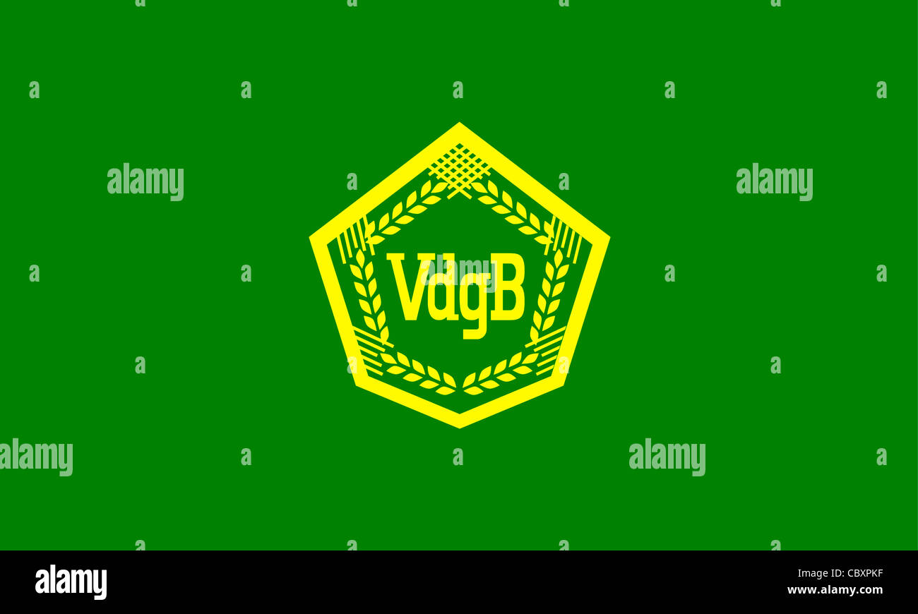 Flag of the Association of mutual agricultural assistance VdgB of the GDR with the logo of the organization. - Stock Image