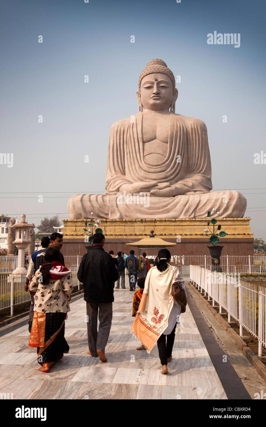 India, Bihar, Bodhgaya, Buddhism, big Buddha statue, Indian tour group arirving - Stock Image