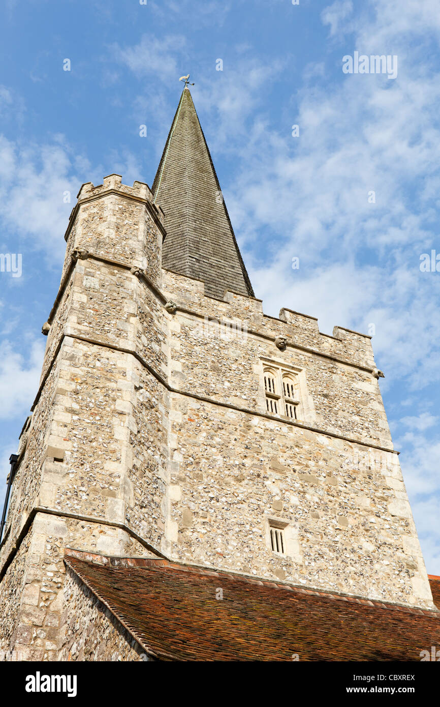 St John the Baptist parish church at Westbourne, West Sussex. With a flint rubble tower and shingle clad spire. - Stock Image