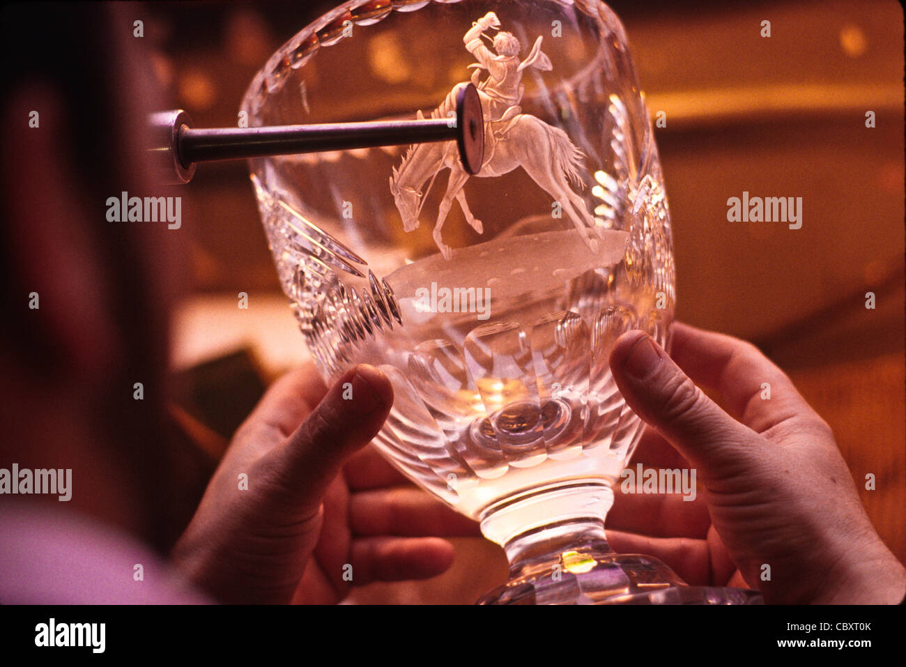 Engraver finishing a western themed crystal vase in Waterford Crystal factory -Waterford, Ireland - Stock Image