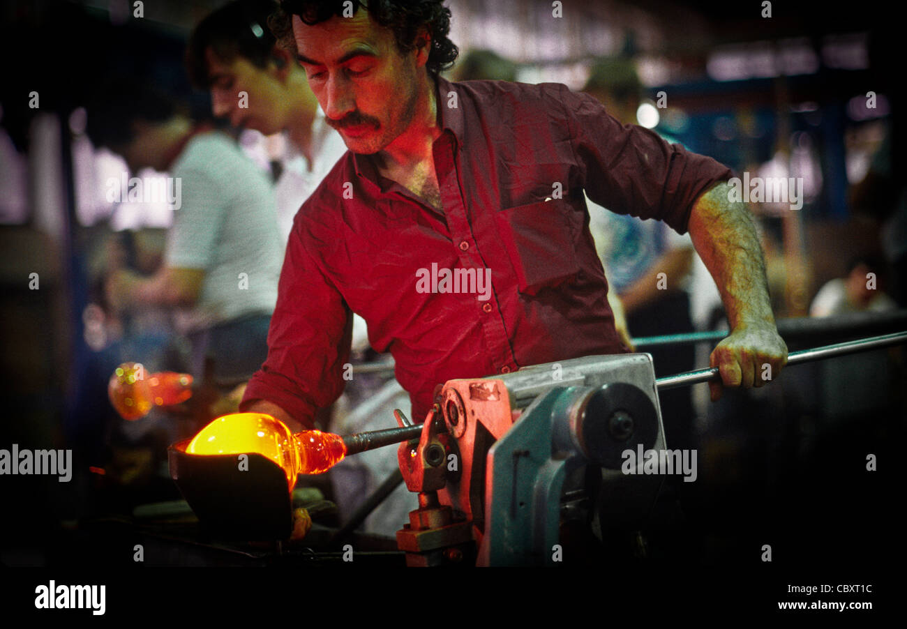 Glass blower shapes hot crystal with a blowing iron in Waterford Crystal factory in 1988, Waterford, Ireland - Stock Image