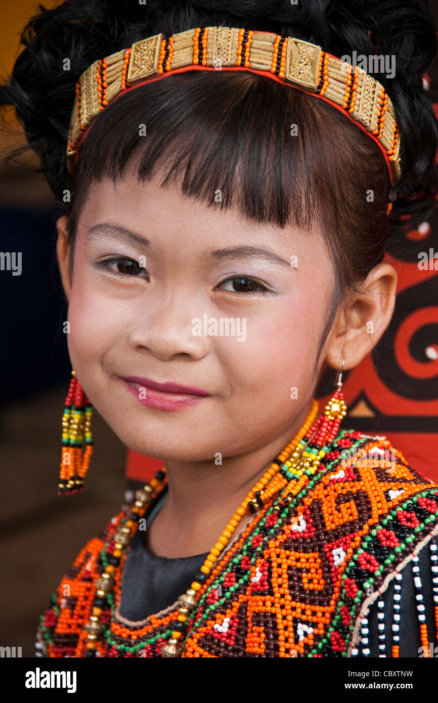 Toraja girl dressed in traditional costume at funeral ceremony in Torajaland (Tana Toraja), South Sulawesi, Indonesia - Stock Image