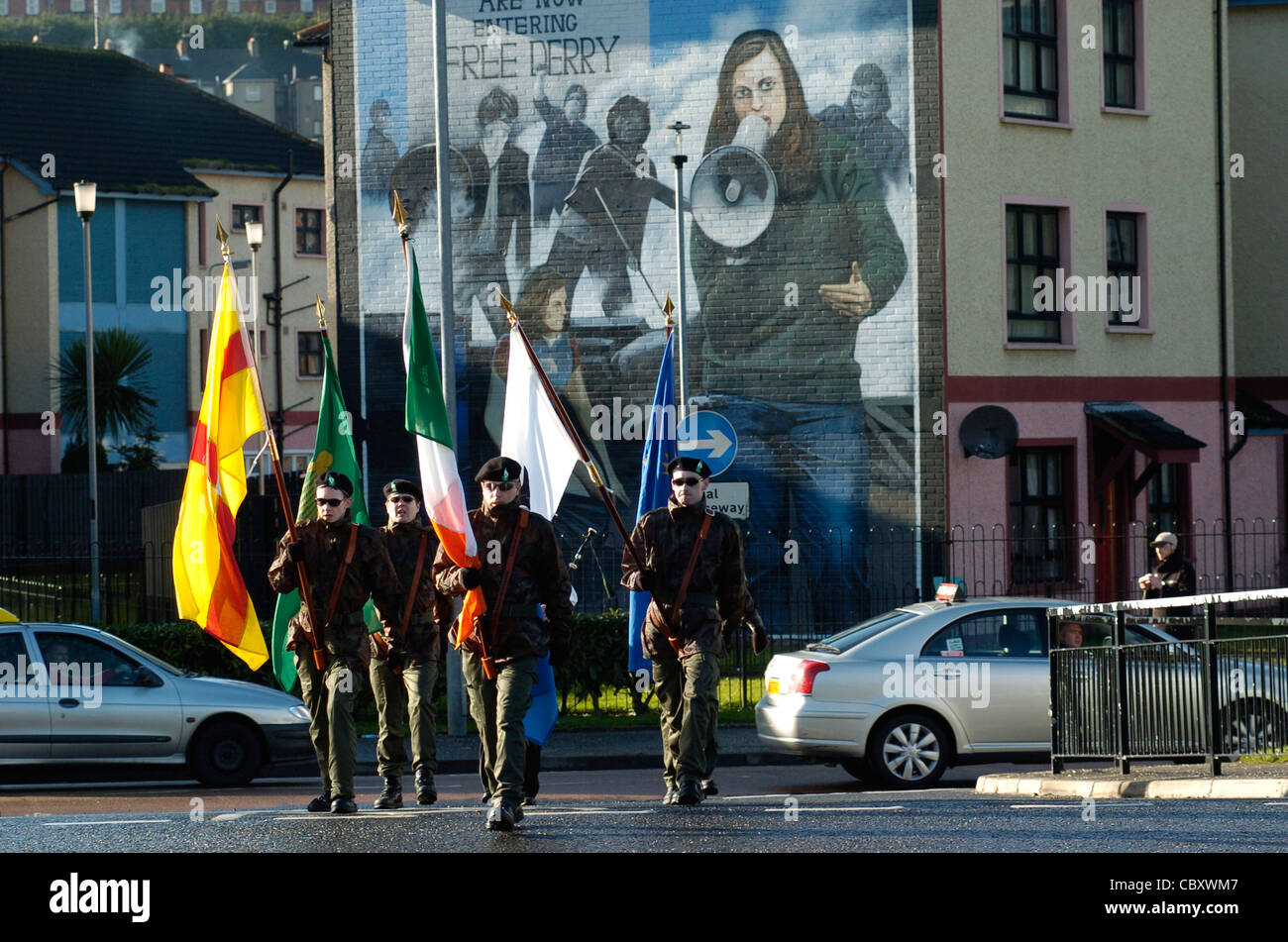Dissident Real IRA colour party at republican commemoration in the Bogside, Londonderry, Northern Ireland. - Stock Image